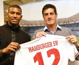 Walace (left) posing with this Hamburg shirt. Goal