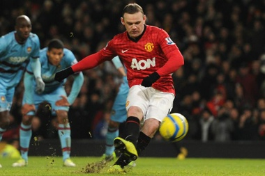 Wayne Rooney pictured scoring a penalty against West Ham United. GOAL