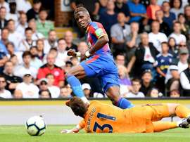 Zaha signed the new deal despite interest from Spurs. GOAL