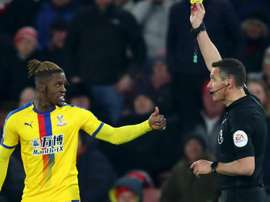 The Crystal Palace winger has been charged for his 'improper' reaction to red card. GOAL