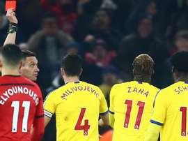 Zaha apologises for red card
