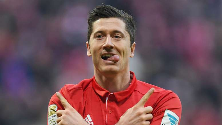 Robert Lewandowski celebrates scoring against RB Leipzig. Goal