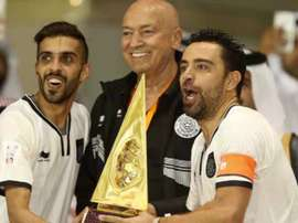 Xavi wins first trophy with Al Sadd. AFP