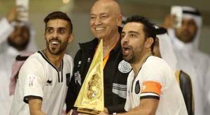 Xavi wins first trophy with Al Sadd. AFP