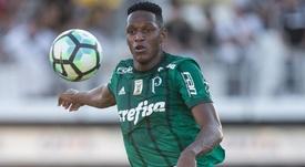 Barcelona want Mina in January, say Palmeiras