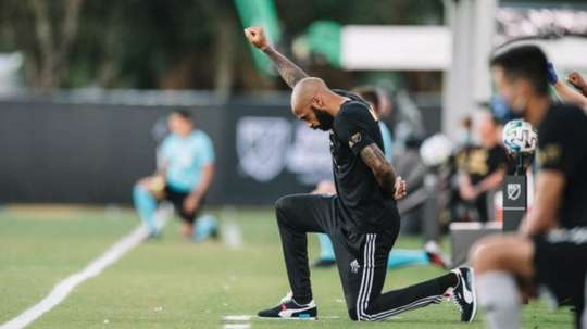 Thierry Henry takes a knee for eight minutes and 46 seconds. Twitter/MLS