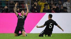 Lucas Ocampos comemorando seu gol diante da Alemanha em jogo amistoso no dia 09-10. AFP