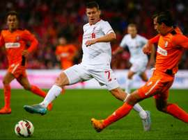 James Milner (L) of English Premier League side Liverpool fights for the ball with Shane Stefanutto of A-League side Brisbane Roar during a friendly at Suncorp Stadium in Brisbane on July 17, 2015.