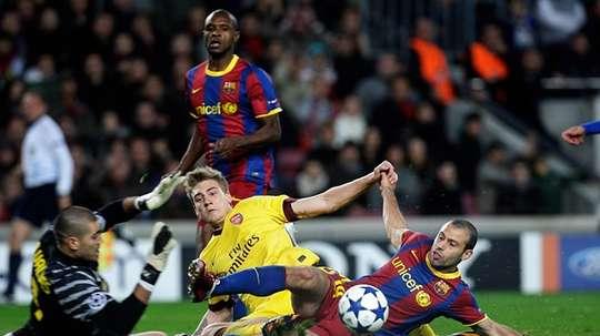 Bendtner in action against Barcelona whilst at Arsenal. AFP