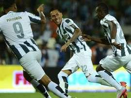 Jefferson Duque, Gilberto García y Marlos Moreno celebran un gol con el Atlético Nacional. Archivo/EFE