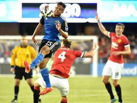 JJ Koval (top) of the San Jose Earthquakes jumps for the ball while fending off Phil Jones of Manchester United during an International Champions Cup match at Avaya Stadium in San Jose, California on July 21, 2015