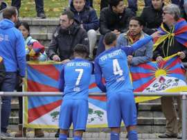 Los aficionados alemanes mostraron banderas del Tíbet en señal de protesta. Captura