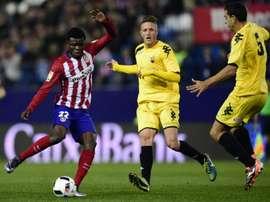 Le milieu de l'Atletico Madrid Thomas Partey (g), buteur face à Reus en Coupe du Roi. AFP