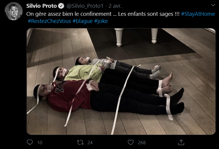 Silvio Proto scotche ses enfants au sol pendant le confinement. AFP