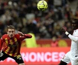 Lens French midfielder Benjamin Bourigeaud (L) challenges Lille Senegalese midfielder Idrissa Gueye during the French L1 football match between Lens and Lille at the Stade de France in Saint-Denis, north of Paris, on December 7, 2014