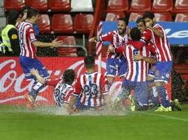 Los futbolistas del Sporting de Gijón celebran el empate logrado ante el Granada en el último suspiro. Twitter