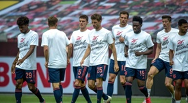 Bayern's players wore anti-racism T-shirts prior to the match with Leverkusen. Twitter/FCBayern