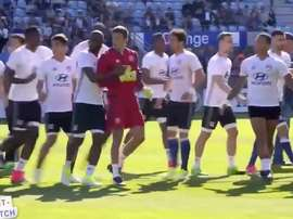 Bastia fans attack Lyon players on pitch. Twitter/OL