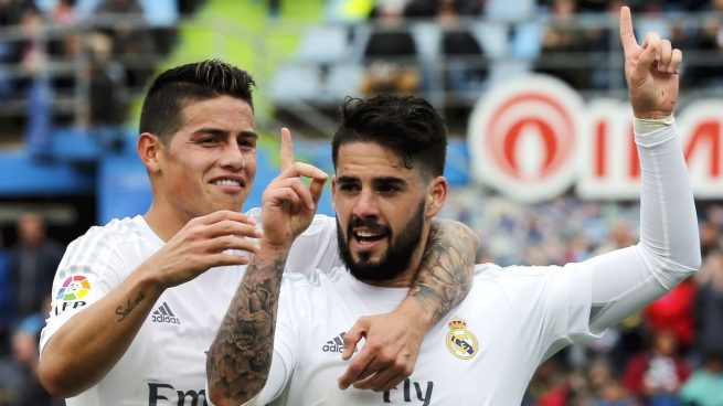 Isco celebrating a goal with James Rodriguez. AFP