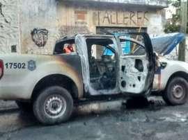 Los violentos incendiaron un coche de Policia junto al estadio. TerritorioDigital