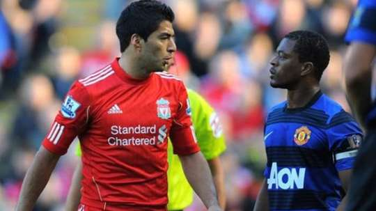 Suarez was banned for racially abusing Evra. AFP