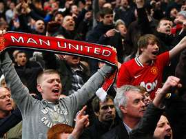 Manchester United fans supporting their club. Twitter