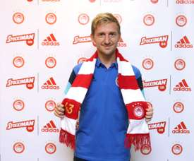 Marin poses with his new club's scarf. Olympiacos