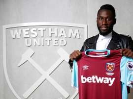 Masuaku poses for photos with the West Ham shirt. WHUFC