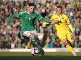 McLaughlin, en un partido con Irlanda del Norte. AFP