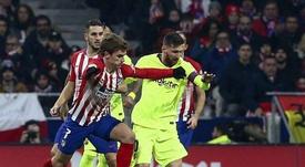 Griezmann bromeó con Messi y Suárez. AFP