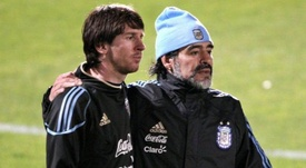 Messi and Maradona both wore the shirt for the Argentine national team. EFE/AFP