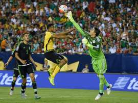Mexico goalkeeper Guillermo Ochoa (R) knocks the ball away from Jamaica Adrian Mariappa during the 2015 CONCACAF Gold Cup final in Philadelphia on July 26, 2015