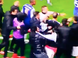 A fan ran on the pitch and pushed Pizzi. Twitter/BenficaAdeptos
