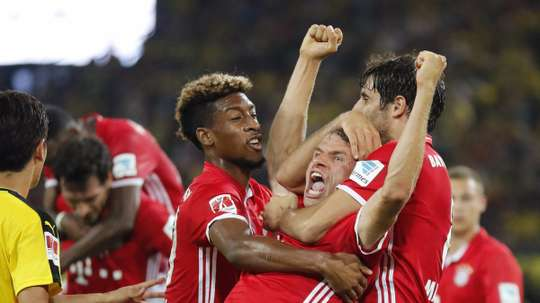 Muller celebrates scoring Bayern's second goal of the evening. FCBayern