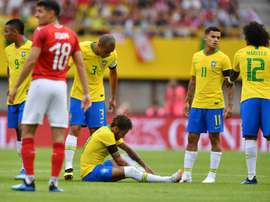 Neymar took a challenge to his ankle early on. AFP