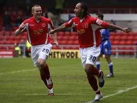 Nicky Maynard (R) scored MK Dons goal in their 4-1 defeat to Brentford. MKDonsFC