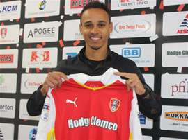 Odemwingie poses with the Rotherham United shirt. The Millers