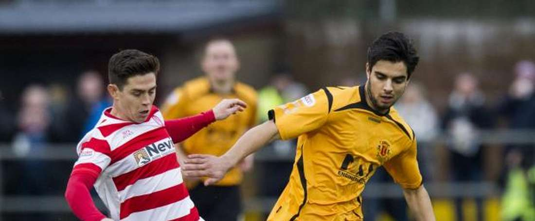 Rabin Omar (R) footballer for Scottish underdogs, Annan Athletic. Twitter