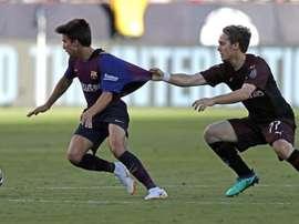 El Barcelona no está demasiado preocupado con el 'marcaje' a Riqui Puig. EFE