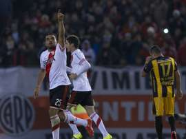 River Plate Gabriel Mercado (L) celebrates after scoring against Guarani during their Libertadores Cup semifinal first leg at the Monumental Antonio Vespucio Liberti stadium in Buenos Aires, on July 14, 2015
