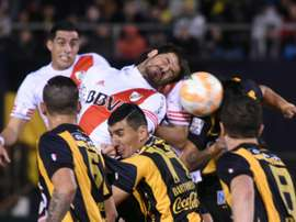 River Plate Rodrigo Mora (C top) heads the ball in the middle of a scramble with Guarani during their Libertadores Cup semi-final second leg match at the Defensores del Chaco stadium in Asuncion, on July 21, 2015