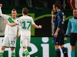 Schürrle y Arnold celebran el tanto del segundo en el Wolfsburgo-Real Madrid de cuartos de Champions. UEFA/AFP