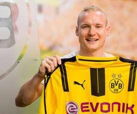 Sebastian Rode posing with the Borussia Dortmund top. BvB