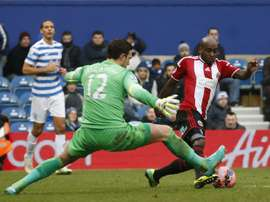 Sheffield United Jamal Campbell-Ryce (R) rounds Queens Park Rangers English goalkeeper Alex McCarthy (C) during the English FA Cup third round football match at Loftus Road Stadium in London, on January 4, 2015