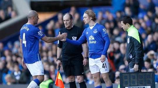 Davies pictured making his debut. AFP
