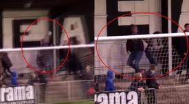 El aficionado salvó a su novia de que la pelota le diera en la cara. Capturas/Twitter/MUFCYorkRoad