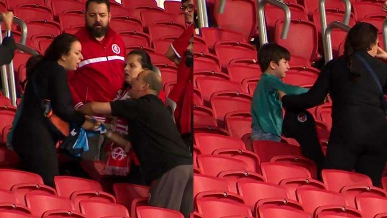 Internacional fans try and take a Gremio shirt off a mother and son. Capturas/SporTV