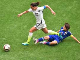 US player Carli Lloyd runs past Japan Aya Miyama during the Women World Cup final at BC Place Stadium in Vancouver.