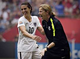 USA coach Jill Ellis (R) and midfielder Carli Lloyd celebrate after winning the FIFA World Cup final 5-2 against Japan at BC Place Stadium during in Vancouver on July 5, 2015
