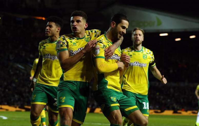 Max Aarons celebrates a goal with Norwich teammates. NorwichCityFc